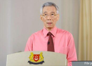 Perdana Menteri Singapura Lee Hsien Loong berbicara dalam pidato yang disiarkan secara langsung kepada publik di Singapura pada 23 Juni 2020. (Xinhua/Kementerian Komunikasi dan Informasi Singapura)